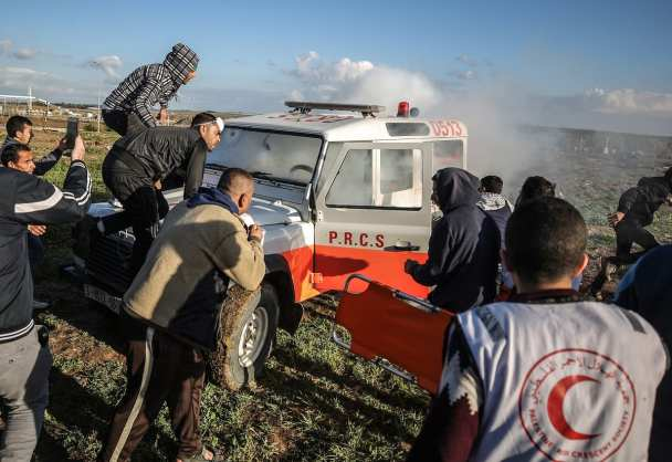 "Israeli forces fire tear gas can in an ambulance during a protest within ""Great March of Return"" demonstrations in Shuja'iyya neighborhood of Gaza City, Gaza on January 18, 2019. ( Ali Jadallah - Anadolu Agency )"